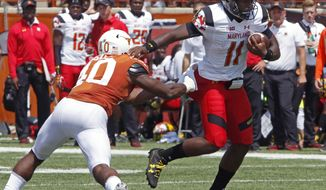 FILE - In this Sept. 2, 2017, file photo, Maryland quarterback Kasim Hill (11) runs the ball against Texas linebacker Naashon Hughes (40) during an NCAA college football game, Saturday in Austin, Texas. Maryland plays Towson this week, with Hill expected to start at quarterback. (AP Photo/Michael Thomas, File)