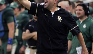 FILE - In this Sept. 2, 2017, file photo, Baylor head coach Matt Rhule calls in a play against Liberty in the first half of an NCAA college football game, in Waco, Texas. Rhule had some setbacks at Temple before a couple of 10-win seasons. The Bears, who lost his debut, are home again Saturday night against a UTSA that didn't play last week because of Hurricane Harvey. (Jerry Larson/Waco Tribune Herald, via AP, File)