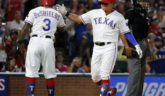 Texas Rangers' Delino DeShields (3) and Shin-Soo Choo celebrate scoring on an Elvis Andrus single during the fifth inning of a baseball game against the New York Yankees on Friday, Sept. 8, 2017, in Arlington, Texas. (AP Photo/Tony Gutierrez)