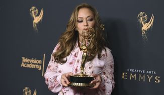 "Leah Remini poses in the press room with the award for outstanding informational series or special for ""Leah Remini: Scientology and the Aftermath"" during night one of the Creative Arts Emmy Awards at the Microsoft Theater on Saturday, Sept. 9, 2017, in Los Angeles. (Photo by Richard Shotwell/Invision/AP)"