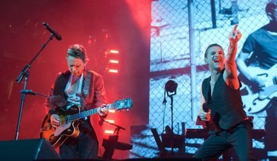 Dave Gahan (right) during Depeche Mode's performance at Capitol One Arena (formerly the Verizon Center) Thursday evening in Washington, D.C.  (Erica Bruce/Special to The Washington Times)