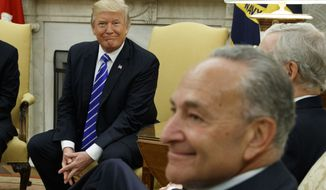 President Donald Trump (left) meets with Senate Minority Leader Chuck Schumer (foreground), New York Democrat, and other Congressional leaders in the Oval Office of the White House on Sept. 6, 2017. (Associated Press) **FILE**