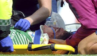 Manchester City's goalkeeper Ederson receives medical treatment during the English Premier League soccer match between Manchester City and Liverpool at the Etihad Stadium in Manchester, England, Saturday, Sept. 9, 2017. (AP Photo/Rui Vieira)