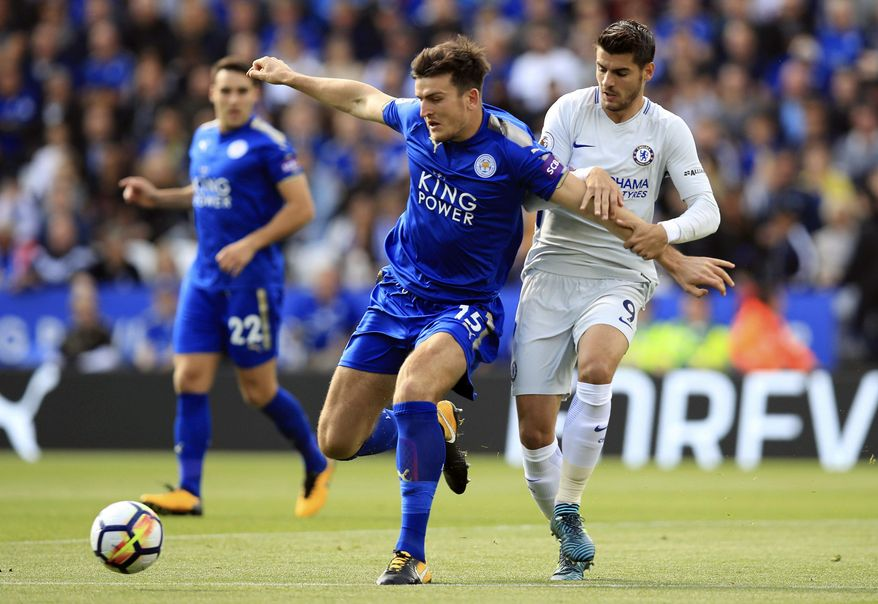Leicester City's Harry Maguire, left, and Chelsea's Alvaro Morata battle for the ball during the English Premier League soccer match at the King Power Stadium, Leicester, England, Saturday Sept. 9, 2017. (Mike Egerton/PA  via AP)