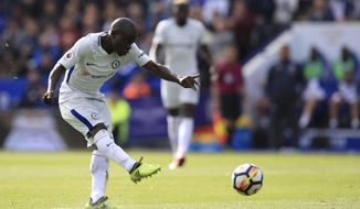 Chelsea's N'Golo Kante scores against Leicester City during the English Premier League soccer match at the King Power Stadium, Leicester, England, Saturday Sept. 9, 2017. (Mike Egerton/PA  via AP)