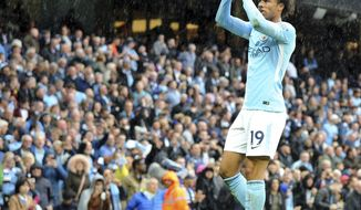 Manchester City's Leroy Sane celebrates after scoring his side's 5th goal during the English Premier League soccer match between Manchester City and Liverpool at the Etihad Stadium in Manchester, England, Saturday, Sept. 9, 2017. Manchester defeated Liverpool by 5-0. (AP Photo/Rui Vieira)