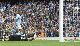 Manchester City's Gabriel Jesus, left, scores his side's 3rd goal during the English Premier League soccer match between Manchester City and Liverpool at the Etihad Stadium in Manchester, England, Saturday, Sept. 9, 2017. (AP Photo/Rui Vieira)