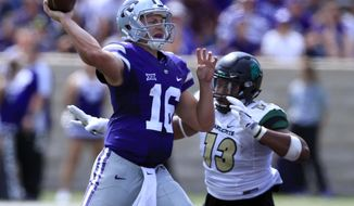 Kansas State quarterback Jesse Ertz (16) throws under pressure from Charlotte defensive lineman Zach Duncan (13) during the second half of an NCAA college football game in Manhattan, Kan., Saturday, Sept. 9, 2017. (AP Photo/Orlin Wagner)