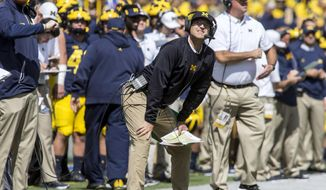 Michigan head coach Jim Harbaugh looks up at the scoreboard from the sideline in the second quarter of an NCAA college football game against Cincinnati in Ann Arbor, Mich., Saturday, Sept. 9, 2017. (AP Photo/Tony Ding)