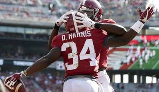 Alabama running back Damien Harris, front, celebrates with wide receiver Cam Sims after Harris scored a touchdown in the first half of an NCAA college football game, Saturday, Sept. 9, 2017, in Tuscaloosa, Ala. (AP Photo/Brynn Anderson)