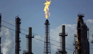 A flame burns at the Shell Deer Park oil refinery in Deer Park, Texas, on Aug. 31, 2017. (Associated Press) **FILE**
