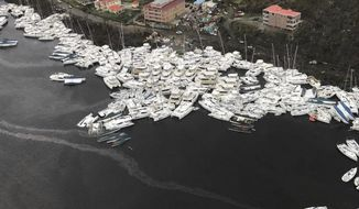 This photo provided by Caribbean Buzz shows boats clustered together after Hurricane Irma Friday, Sept. 8, 2017. The death toll from Hurricane Irma has risen to 22 as the storm continues its destructive path through the Caribbean.The dead include 11 on St. Martin and St. Barts, four in the U.S. Virgin Islands and four in the British Virgin Islands. There was also one each in Barbuda, Anguilla, and Barbados. The toll is expected to rise as rescuers reach some of the hardest-hit areas. (Caribbean Buzz via AP)