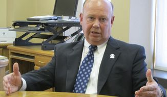 In this Thursday, Sept. 7, 2017 photo, Kansas Corrections Secretary Joe Norwood answers questions from The Associated Press during an interview in Topeka, Kan. Norwood says he doesn't see connections between a recent riot at a prison in Norton and earlier disturbances at a prison in El Dorado Kan. (AP Photo/John Hanna)