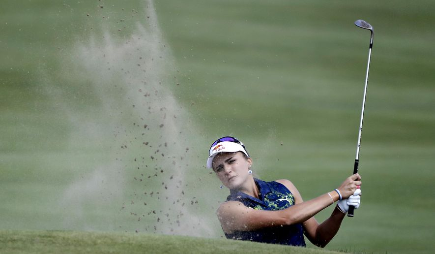 Lexi Thompson hits out of a bunker on the eighth hole during the final round of the Indy Women in Tech Championship golf tournament, Saturday, Sept. 9, 2017, in Indianapolis. (AP Photo/Darron Cummings)