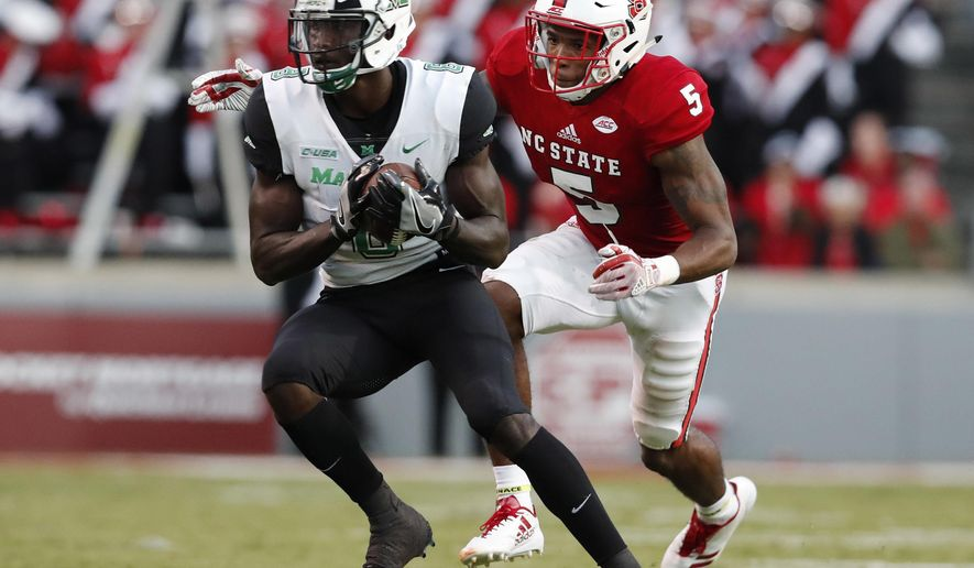 Marshall wide receiver Tyre Brady (8) beats North Carolina State cornerback Johnathan Alston (5) for a 75-yard touchdown reception during the first half of an NCAA college football game Saturday, Sept. 9, 2017, in Raleigh, N.C. (Ethan Hyman/The News & Observer via AP)