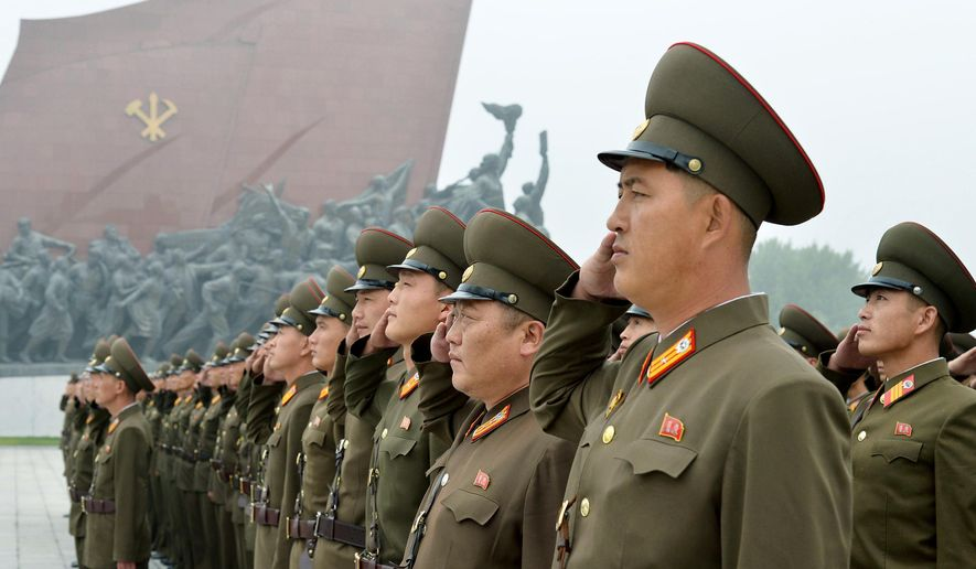 North Korean soldiers salute at Munsu Hill in Pyongyang, North Korea to mark the 69th anniversary of the country's founding Saturday, Sept. 9, 2017. (Kyodo News via AP)