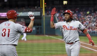 Philadelphia Phillies' Maikel Franco, right, celebrates his home run with Hyun Soo Kim (31), of South Korea, during the second inning of a baseball game against the Washington Nationals, Saturday, Sept. 9, 2017, in Washington. (AP Photo/Nick Wass)
