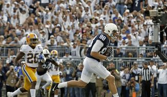 Penn State's Mike Gesicki (88) goes in for a touchdown after a catch against Pittsburgh during the first half of an NCAA college football game in State College, Pa., Saturday, Sept. 9, 2017. (AP Photo/Chris Knight)