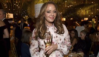 "Leah Remini holds her award for outstanding informational series or special for ""Leah Remini: Scientology and the Aftermath"" at the Governors Ball during night one of the Creative Arts Emmy Awards at the Microsoft Theater on Saturday, Sept. 9, 2017, in Los Angeles. (Photo by Richard Shotwell/Invision/AP)"