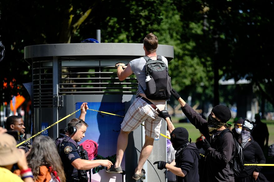 A pro-Trump supporter tries to get his hat back in Portland, Ore., on September 10, 2017, after he was confronted by antifascist protesters gathering against a rally by right-aligned Patriot Prayer supporters led by Joey Gibson. Only a few Patriot Prayer members showed up and police used pepper spray after protesters pushed down a barrier separating the groups. (Photo by Alex Milan Tracy)(Sipa via AP Images)