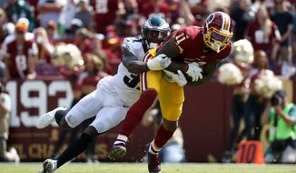 Washington Redskins wide receiver Terrelle Pryor, right, rushes against Philadelphia Eagles cornerback Jalen Mills in the first half of an NFL football game, Sunday, Sept. 10, 2017, in Landover, Md. (AP Photo/Alex Brandon)