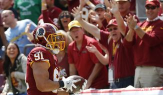 Washington Redskins outside linebacker Ryan Kerrigan celebrates after running an interception back for a touchdown in the first half of an NFL football game against the Philadelphia Eagles, Sunday, Sept. 10, 2017, in Landover, Md. (AP Photo/Alex Brandon)