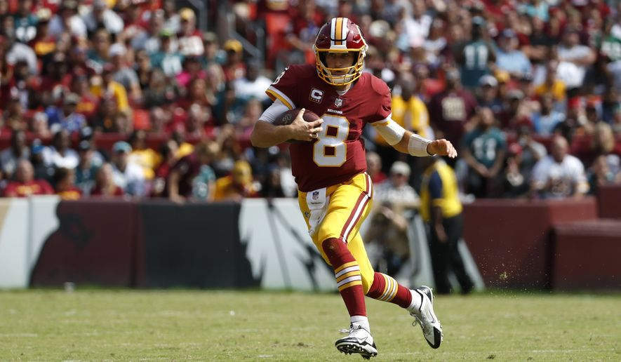 Washington Redskins quarterback Kirk Cousins rushes the ball in the second half of an NFL football game against the Philadelphia Eagles, Sunday, Sept. 10, 2017, in Landover, Md. (AP Photo/Alex Brandon)