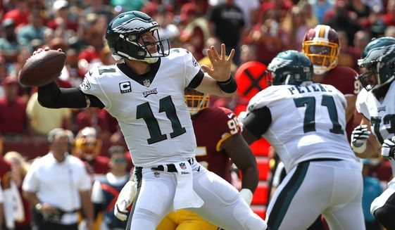 Philadelphia Eagles quarterback Carson Wentz (11) throws to a receiver in the first half of an NFL football game against the Washington Redskins, Sunday, Sept. 10, 2017, in Landover, Md. (AP Photo/Alex Brandon)