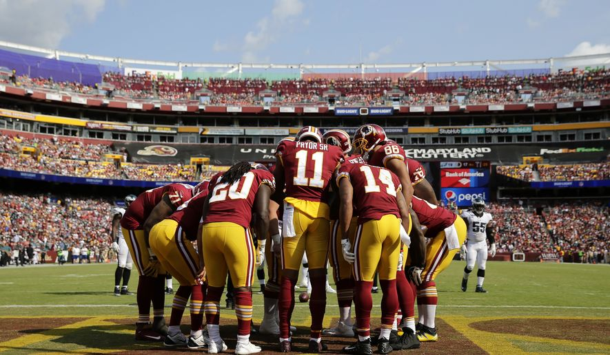 Washington Redskins wide receiver Terrelle Pryor (11) huddles with teammates in the second half of an NFL football game against the Philadelphia Eagles, Sunday, Sept. 10, 2017, in Landover, Md. (AP Photo/Mark Tenally)