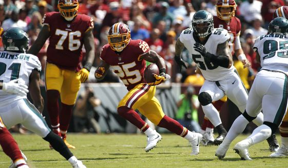 Washington Redskins running back Chris Thompson (25) rushes the ball in the first half of an NFL football game against the Philadelphia Eagles, Sunday, Sept. 10, 2017, in Landover, Md. (AP Photo/Alex Brandon)