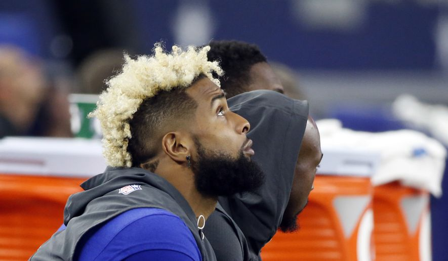 New York Giants wide receiver Odell Beckham Jr. looks up at the large video screen from the sideline in the second half of an NFL football game against the Dallas Cowboys on Sunday, Sept. 10, 2017, in Arlington, Texas. (AP Photo/Michael Ainsworth)