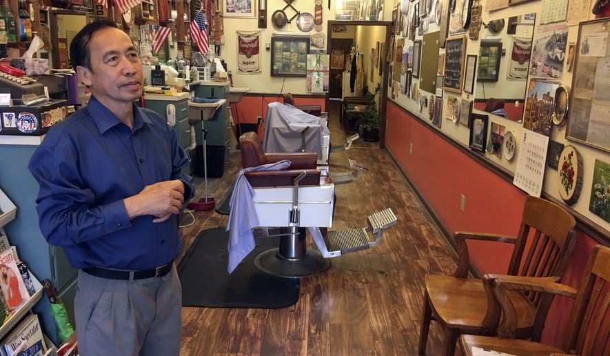 In this Sept. 6, 2017, photo, Anthony Pham, talks in his Monroe, Ga., barber shop. He became a U.S citizen in 1987, five years after he immigrated from Vietnam.   Now a business owner and proud Republican in Georgias staunchly conservative 10th Congressional District, Pham says he supports maintaining legal status for immigrants who arrived in the country illegally as children, the so-called Dreamers brought by adult family members.  (AP Photo/Bill Barrow)