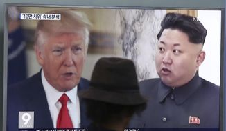 In this Aug. 10, 2017, file photo, a man watches a television screen showing U.S. President Donald Trump and North Korean leader Kim Jong-un during a news program at the Seoul Train Station in Seoul, South Korea. North Korea said Monday, Sept. 11, 2017, it will make the United States pay a heavy price if a proposal Washington is backing to impose the toughest sanctions ever on Pyongyang is approved by the U.N. Security Council this week. (AP Photo/Ahn Young-joon, File)