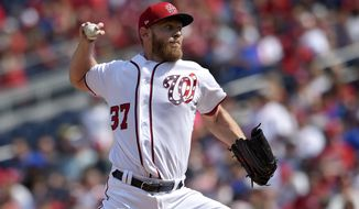 Washington Nationals starting pitcher Stephen Strasburg delivers during the third inning of a baseball game against the Philadelphia Phillies, Sunday, Sept. 10, 2017, in Washington. (AP Photo/Nick Wass)