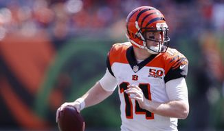 Cincinnati Bengals quarterback Andy Dalton looks to pass in the second half of an NFL football game against the Baltimore Ravens, Sunday, Sept. 10, 2017, in Cincinnati. (AP Photo/Gary Landers) **FILE**