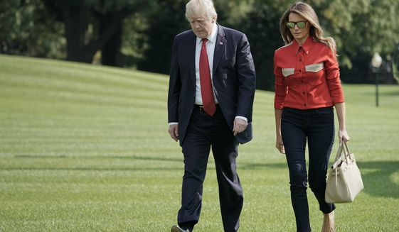 President Donald Trump and first lady Melania Trump walk across the South Lawn of the White House in Washington during their arrival on Marine One helicopter, Sunday, Sept. 10, 2017. Trump his family and staff where returning from presidential retreat at Camp David, Md. (AP Photo/Pablo Martinez Monsivais)