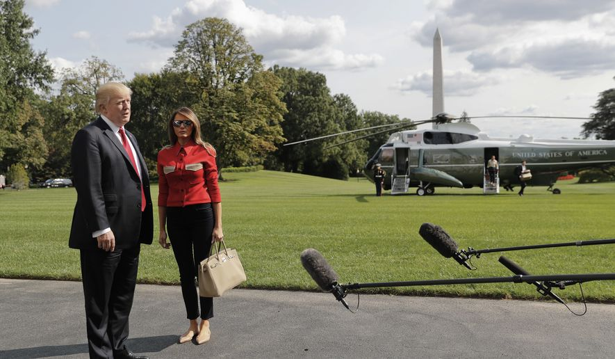 """President Donald Trump stops to answers questions, accompanied by first lady Melania Trump, on at South Lawn of the White House in Washington, Sunday, Sept. 10, 2017. Trump commented on the response to Hurricane Irma which he called """"some big monster,"""" and praised both FEMA and the Coast Guard for their efforts as the storm made landfall. (AP Photo/Pablo Martinez Monsivais)"""