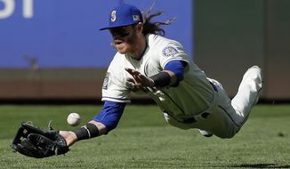 Seattle Mariners left fielder Ben Gamel dives for but cannot catch a single hit by Los Angeles Angels' Kole Calhoun in the eighth inning of a baseball game, Sunday, Sept. 10, 2017, in Seattle. (AP Photo/Ted S. Warren)