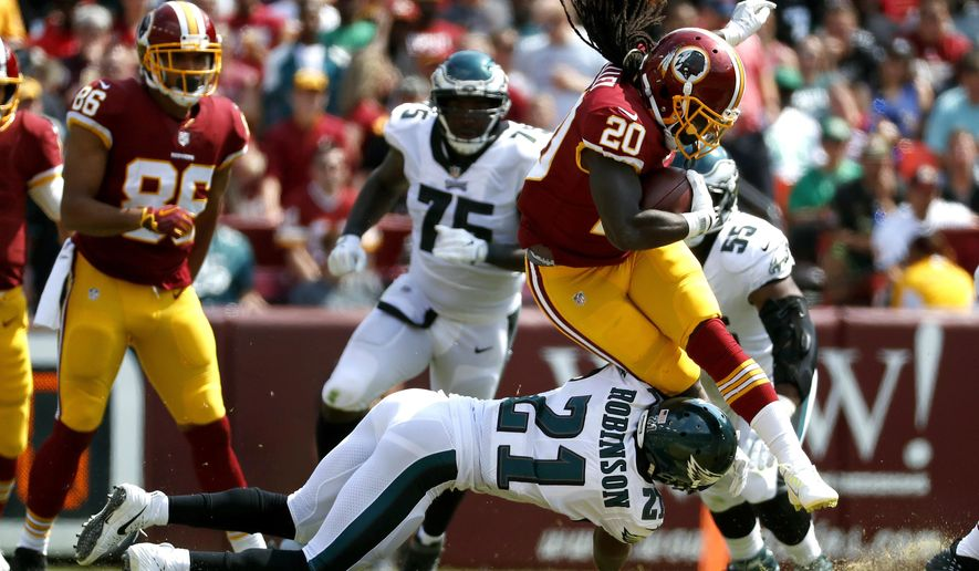 Washington Redskins running back Rob Kelley (20) is tackled by Philadelphia Eagles defensive back Patrick Robinson as he rushes the ball in the first half of an NFL football game, Sunday, Sept. 10, 2017, in Landover, Md. (AP Photo/Alex Brandon)
