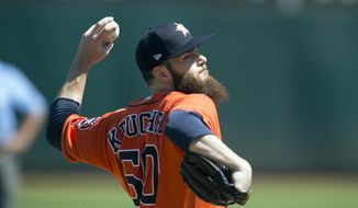 Houston Astros starting pitcher Dallas Keuchel (60) delivers against the Oakland Athletics during the first inning of a baseball game, Sunday, Sept. 10, 2017, in Oakland, Calif. (AP Photo/D. Ross Cameron)