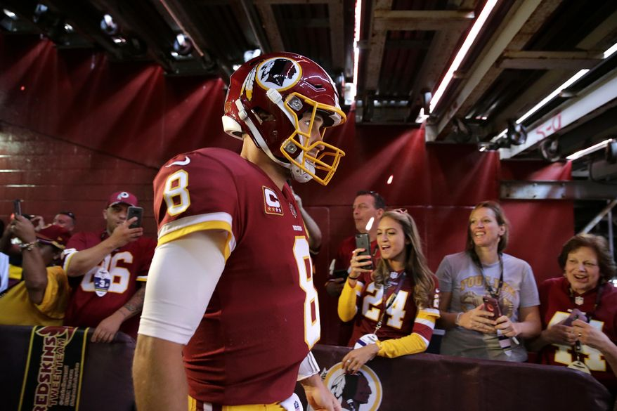 Washington Redskins quarterback Kirk Cousins walks out of a tunnel to the field before an NFL football game against the Philadelphia Eagles, Sunday, Sept. 10, 2017, in Landover, Md. (AP Photo/Mark Tenally)