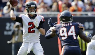 Atlanta Falcons quarterback Matt Ryan (2) throws against Chicago Bears linebacker Leonard Floyd (94) during the second half of an NFL football game, Sunday, Sept. 10, 2017, in Chicago. (AP Photo/Michael Conroy)