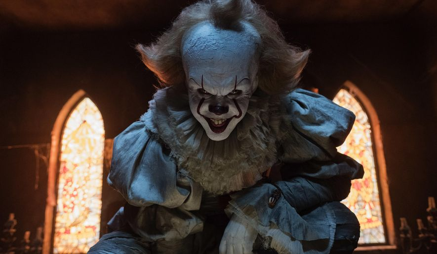 "This image released by Warner Bros. Pictures shows Bill Skarsgard in a scene from ""It."" (Brooke Palmer/Warner Bros. Pictures via AP)"