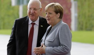 German Chancellor Angela Merkel, right, welcomes Israeli President Reuven Rivlin for a meeting at the chancellery in Berlin, Germany, Thursday, Sept. 7, 2017. (AP Photo/Markus Schreiber)