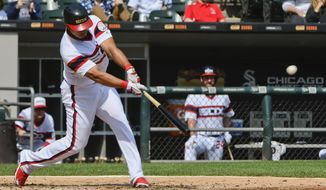 Chicago White Sox's Jose Abreu hits a two-run home run against the San Francisco Giants during the second inning of a baseball game in Chicago, Sunday, Sept. 10, 2017. (AP Photo/Matt Marton)