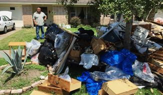 Salvador Cortez, 58, shows debris in the front yard of his home in Houston on Saturday, Sept. 9, 2017. Unable to afford an alternative and awaiting a solution from the Federal Emergency Management, he is sleeping in his musty, flood-gutted home. (AP Photo/Frank Bajak)