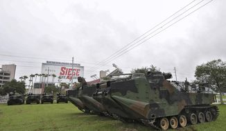 National Guard amphibious vehicles stage at Raymond James Stadium Sunday, Sept. 10, 2017, in Tampa, Fla., as Hurricane Irma continues to churn towards the state. As Irma marches up Florida's Gulf Coast toward Tampa Bay, residents fear what the storm will do to an area that hasn't taken a direct hit from a major hurricane since 1921. (AP Photo/Chris O'Meara)