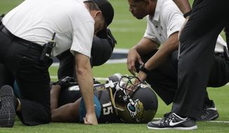 Jacksonville Jaguars wide receiver Allen Robinson (15) is tended to by medical staff after an injury while facing the Houston Texans in the first half of an NFL football game Sunday, Sept. 10, 2017, in Houston. (AP Photo/David J. Phillip)