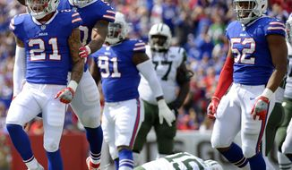 Buffalo Bills' Jordan Poyer (21) celebrates with teammates after sacking New York Jets quarterback Josh McCown (15) during the first half of an NFL football game Sunday, Sept. 10, 2017, in Orchard Park, N.Y. (AP Photo/Adrian Kraus)