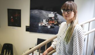 In this Aug. 7, 2017 photo, Stevie Holly-Knox, a Columbia Basin College student, poses inside of The Moore Observatory at Columbia Basin College in Pasco, Wash.. Holly-Knox will be transferring to University of Washington to finish her degree in astrophysics. She is one of 100 students nationwide who earned a trip to visit NASA. (Noelle Haro-Gomez/The Tri-City Herald via AP)